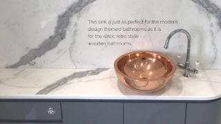 Round Double Wall Copper Sink installed in modern bathroom.