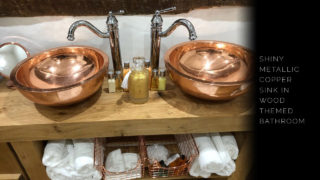 Round Double Wall Copper Sink paired with wood themed bathroom.